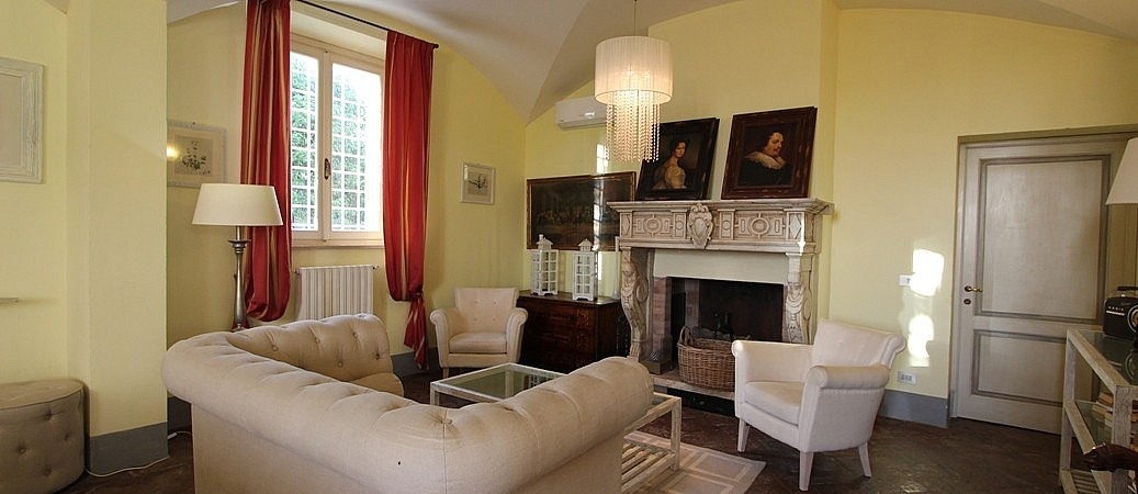Sitting room and fireplace of a large villa for 18 people
