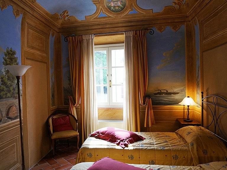 Elegant frescoed bedroom in Renaissance villa