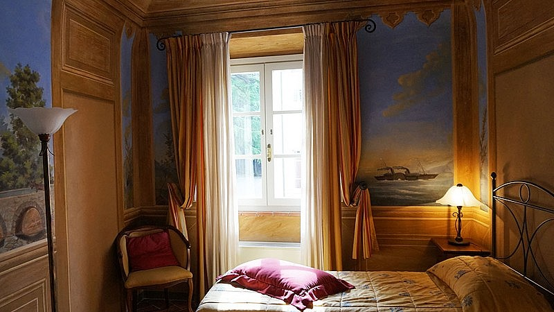 Elegant frescoed bedroom in Renaissance villa