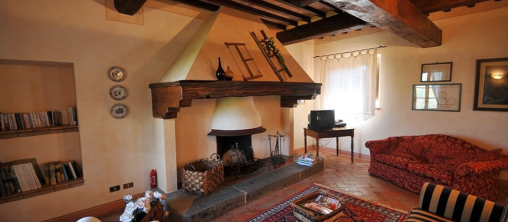 Tuscan fireplace in sitting room of villa