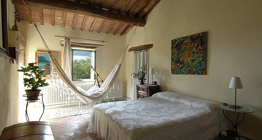 Bedroom in rustic Tuscan style
