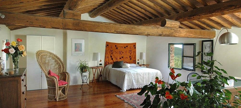 Large master bedroom in Tuscan country cottage