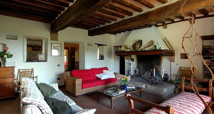 Living room with huge fireplace in Tuscany