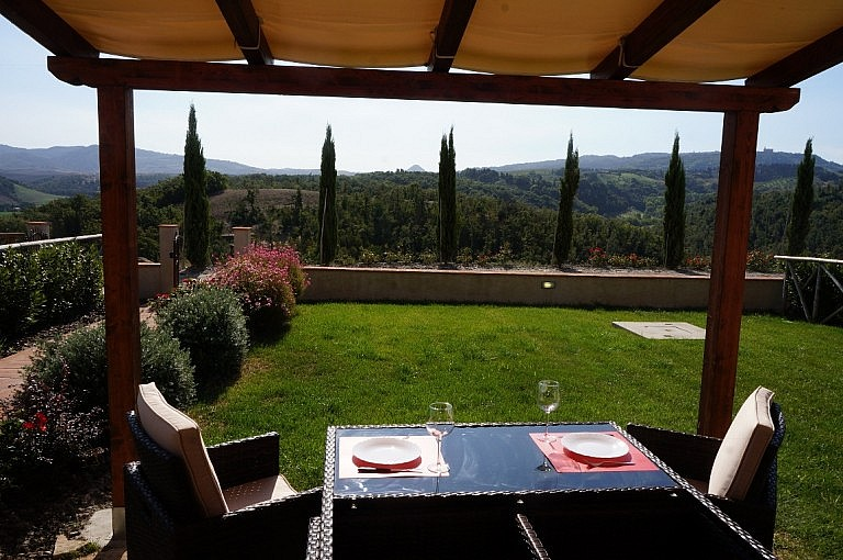Gazebo with outdoor table with view over Volterra