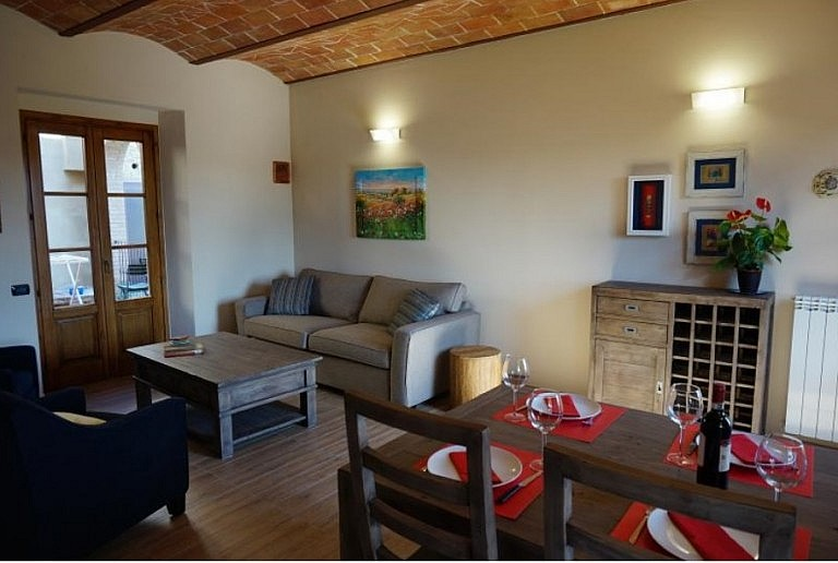 Living room with double sofa bed in comfortable unit with pool