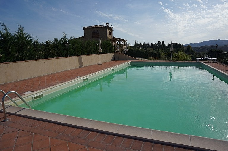 Apartments on hilltop with communal pool in Volterra