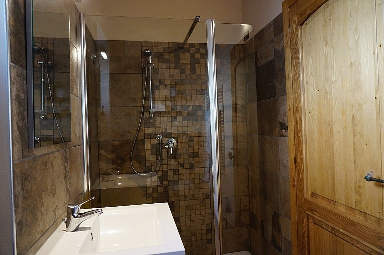 Beautiful stone tiled bathroom and shower in Tuscan holiday apartment