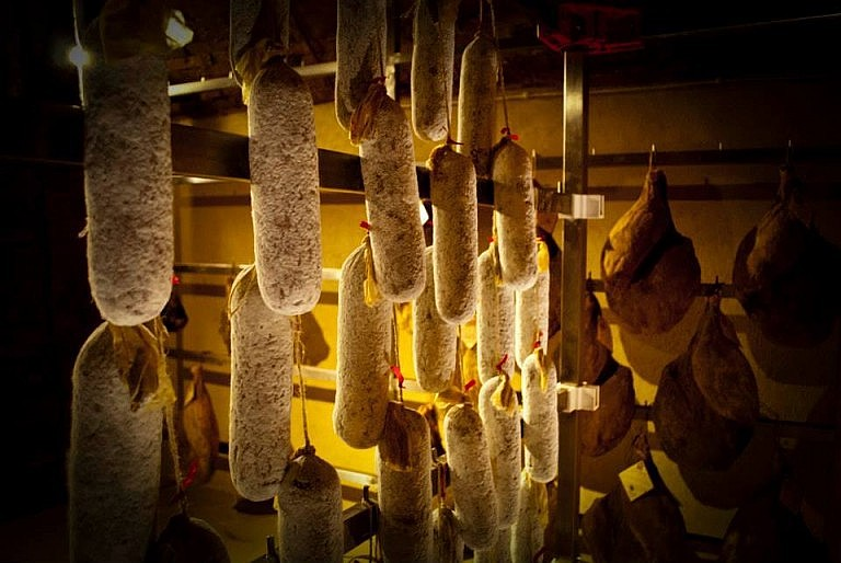 Tuscan salami developing natural mould in the ageing