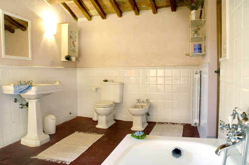 Bathroom with tub in unit of a Tuscan castle