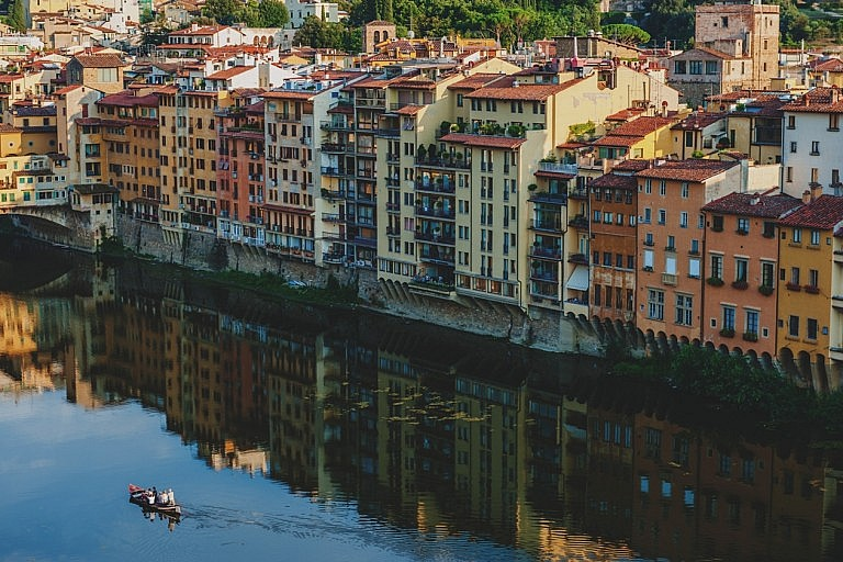 Palaces mirroring in the Arno river in Florence