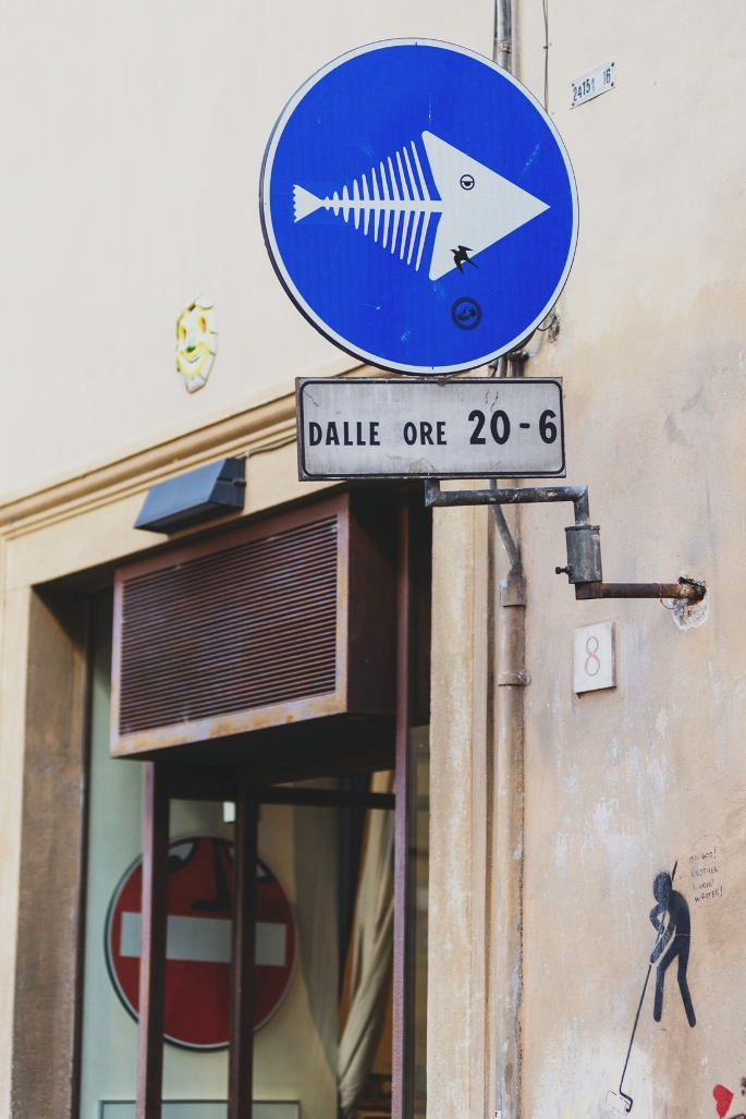 Street art on road signs in Florence