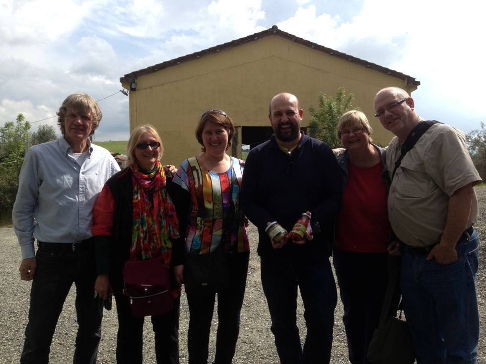 Massimo and a family visiting the cheese farm