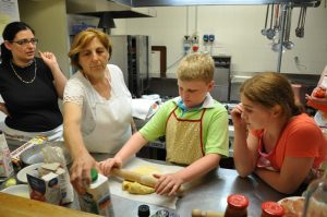 Children making a cake with Ester