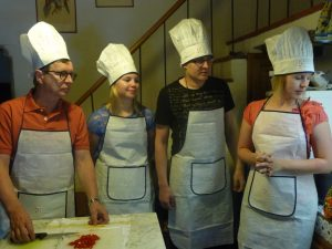 A family from Finland doing a cooking class in Tuscany