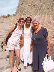 A granny from Lari poses with our guests