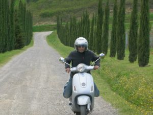 Renting a vespa scooter during a honeymoon in Tuscany