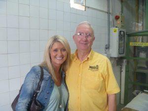 A smiling honeymooner next to Dino the pasta maker