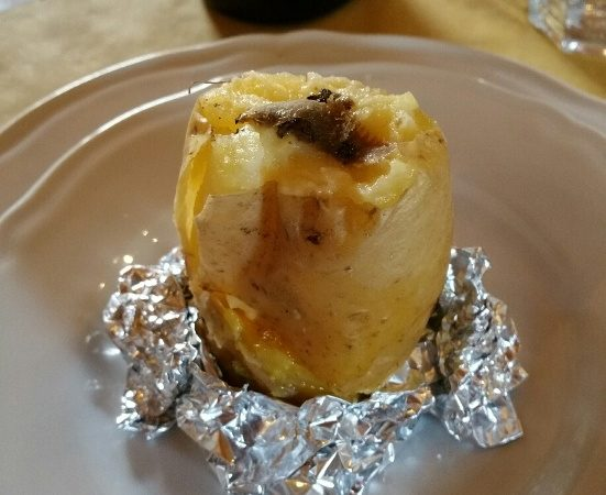 Boiled potato with butter and freshly shaven truffle on top