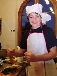 Teenager using a mezzaluna knife