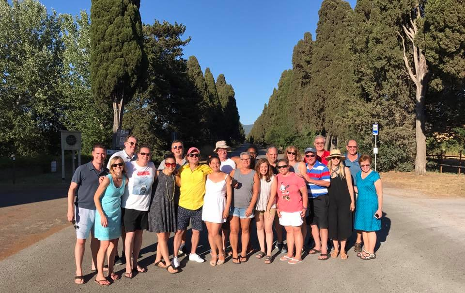 A lovely group of friends along the cypress boulevard in Bolgheri