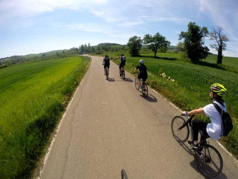 Across Tuscan rolling hills on a bike