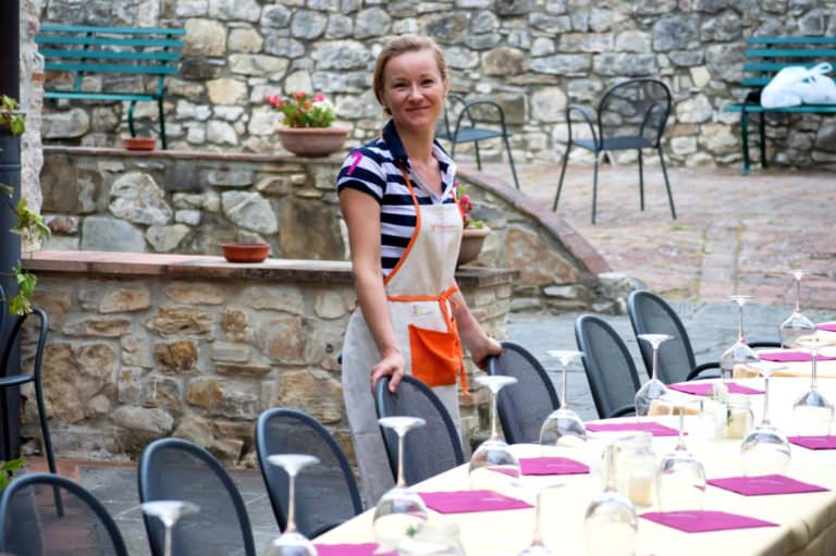 Natalia setting the table for 20 guests