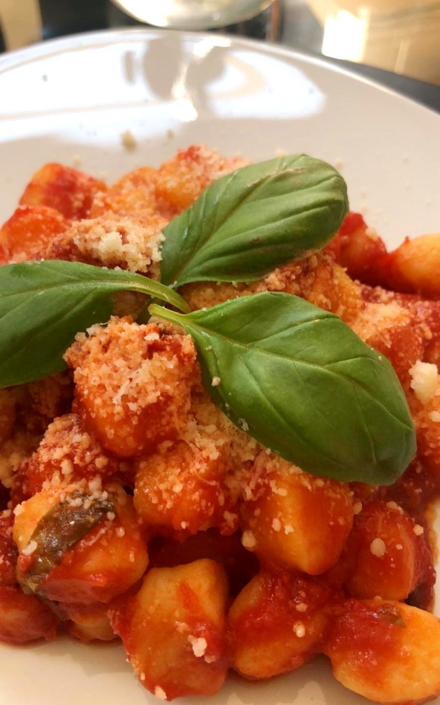 Home-made gnocchi with tomato and basil sauce